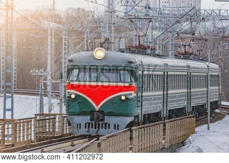 Retro Passenger Train Approaches To The Station. Moscow. Russia.