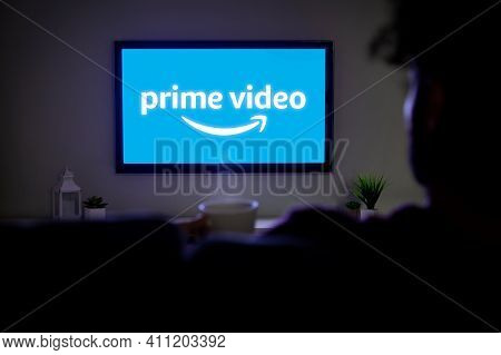 Rosario, Argentina - March 4, 2021: Amazon Prime Video Logo On The Screen Of Led Smart Tv. Afro Man