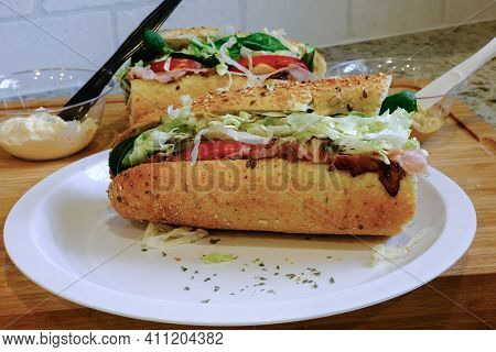 Sub Sandwich On Plate With Mayo And Mustard