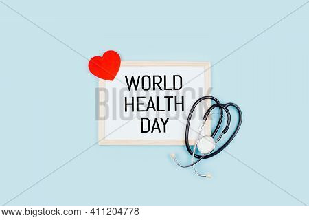 World Health Day, Medical And Healthcare. Stethoscope And Text World Health Day In Frame On Blue Bac