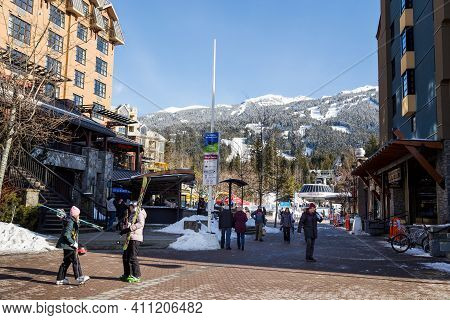Whistler, Bc, Canada - Feb 28, 2021: Whistler Village With People During The Covid 19 Pandemic.