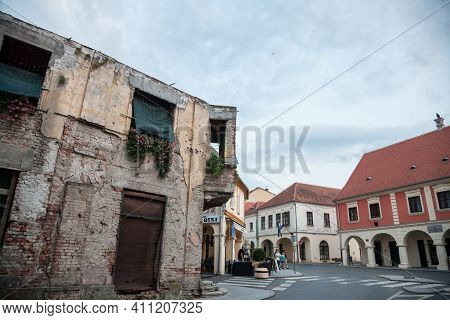 Vukovar, Croatia - May 12, 2018: Damaged House With Bullet Impacts From 1991 Conflict On Franjo Tudj