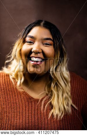 Black Girl Laughing Wearing Burnt Orange Sweater