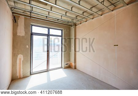 A New Apartment Repair Works In Progress, Plastering, Hanging Drywalls And Ceiling Leveling