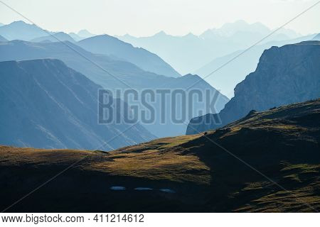Awesome Aerial View To Great Mountains In Distance Behind Deep Gorge. Scenic Mountain Landscape With