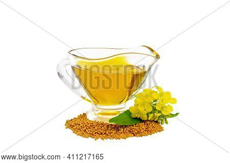 Oil Mustard In Gravy Boat With Seeds And Flower