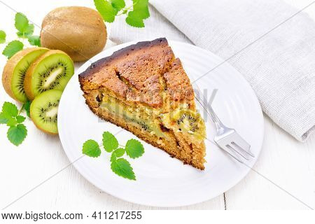 Pie With Kiwi In Plate On Wooden Board