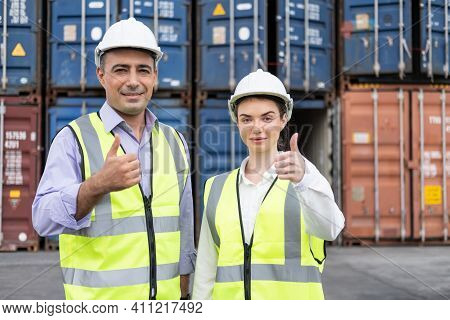 Caucasian Men And Women Freight  Supervisor Wearing Safety Vest And Hat Doing Thumbs Up While Inspec