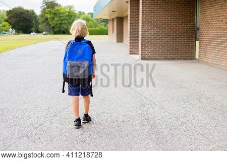 Little Boy Walking To School, Carrying Backpack. Back To School Concept.