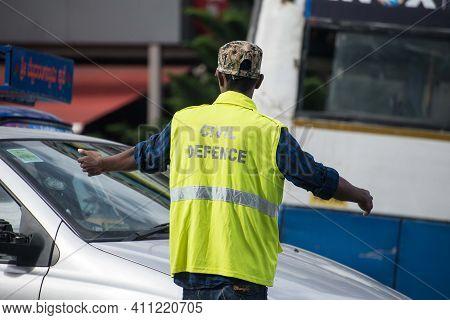 Bangalore, India : Jun 24 2017, A Civil Defence Volunteer Manages The Traffic