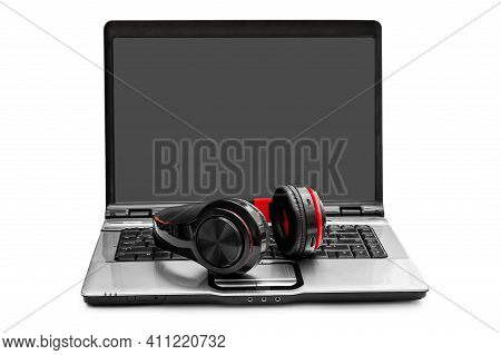 Laptop With Bluetooth Headphones Isolated On White.