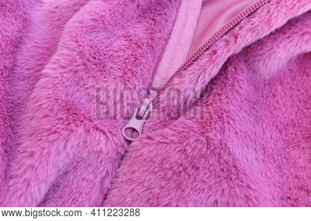 Fluffy Pink Faux Fur With Open Pink Zipper, Texture Of Fashionable Fur Fabric. Small Dept Of Focus.