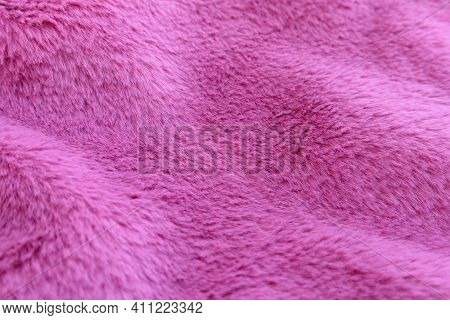 Perspective View Of Waves Of Fluffy Pink Faux Fur, Texture Of Fashionable Fur Fabric. Small Dept Of