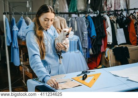 Small Business, Fashion Designer, Tailor Working, Dressmaker Workplace. Candid Portrait Of Fashion D