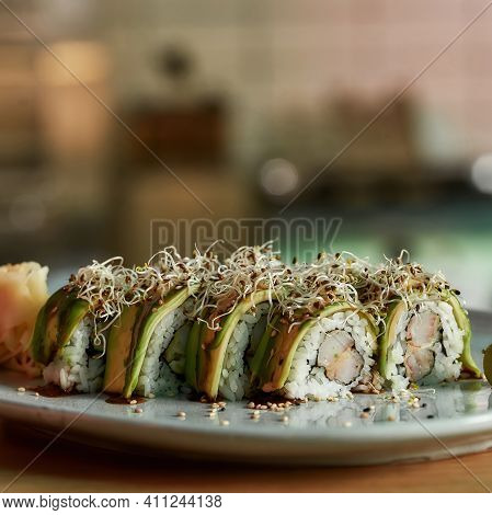 Sushi With Rice And Eel Are On A Plate In A Restaurant. Healthy Sushi With Seafood Lying On A Plate
