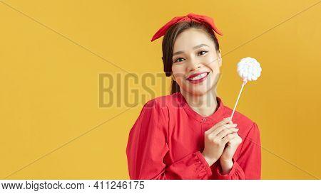 Beautiful Woman Holding Big Lollipop Candy In Hand. Sweet Food Fun Concept.