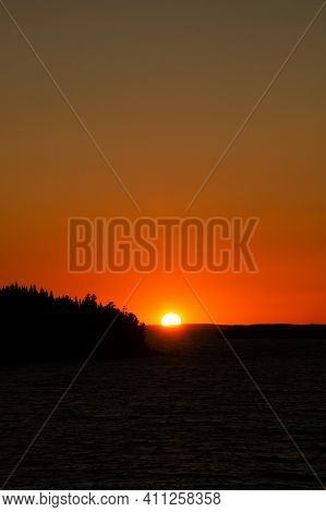 The Sun Sets Over The Horizon, Sky Is Bright At Sunset. Beautiful Photo Of Summer Twilight