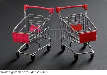 Empty Metal Shopping Carts From A Supermarket On A Gray Background. The Concept Of Economic Crisis,