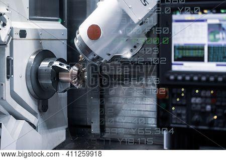 Cnc Milling Or Turning Machine Cutting Bevel Gear With Milling Spindle. Mutitasking Cnc Lathe Machin