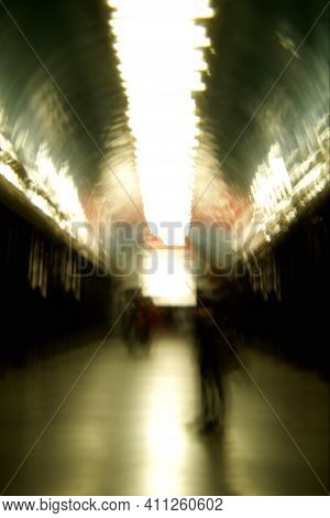 Human Silhouettes In A Subway In Blur. Blurry Image Of A Subway.