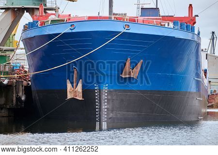 Front View Of Moored Large Cargo Ship. Freighter In Shipyard. Seaport, Container Ship Terminal. Busi