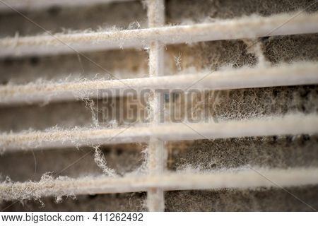 Extremely Dirty Air Ventilation Grill Of Hvac With Dusty Clogged Filter, Close Up, Macro. Cleaning A