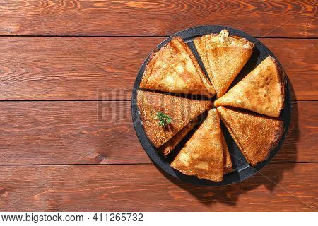 Thin Pancakes From Russian Cuisine. Russian Blini, Crepes On A Wooden Background. Shrovetide Holiday