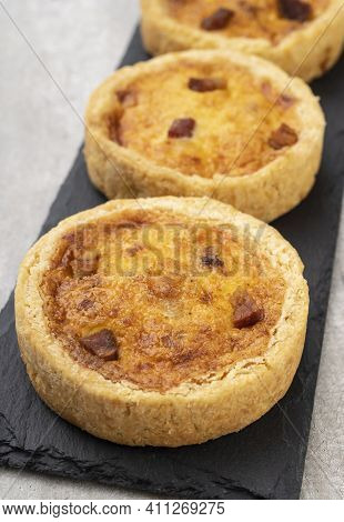 Homemade Quiche Lorraine Over Stone Board. Traditional Bacon And Cheese French Pie.