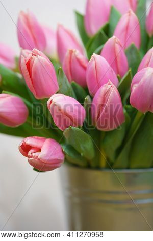 Bouquet Of Tulips In An Iron Bucket.