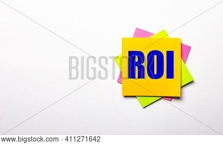 On A Light Background - Bright Multicolored Stickers With The Text Roi Return On Investment. Copy Sp
