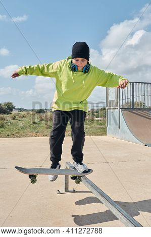 Young, Teenager, With Skateboard, Jumping, On The Track, With Headphones,