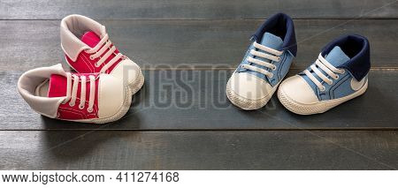Baby Shoes On Blue Wooden Floor Color Background