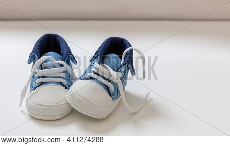 Baby Boy Shoes On White Color Background, Closeup View,