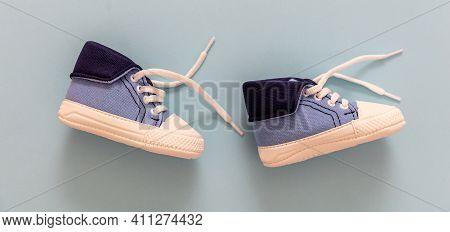 Baby Boy Shoes On Pastel Blue Color Background, Closeup