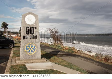 Campbell River, Canada - November 17,2020: View Of Sign 50th Parallel With Campbell River In The Bac