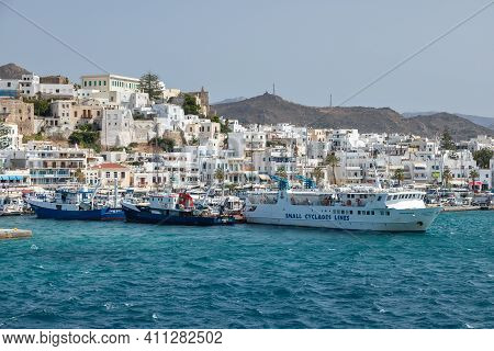 Naxos Island, Greece- 26 September 2020: Boats And Sailing Ship Moored At The Harbor Wharf. White Tr