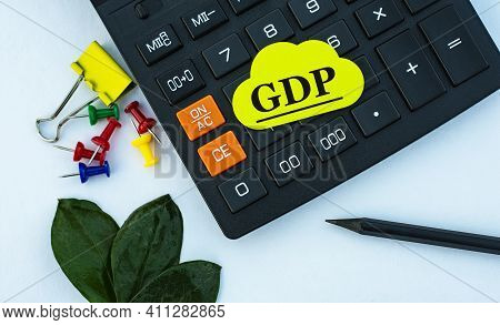 Gdp (gross Domestic Product) - Acronym On Yellow Note Paper On The Calculator. On A White Background