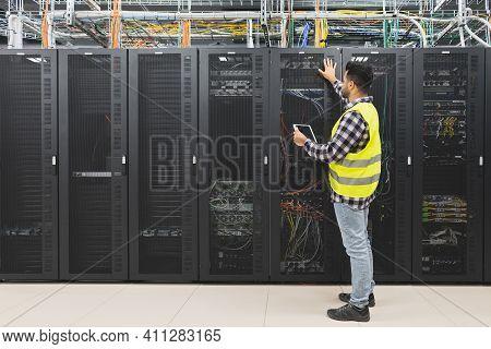 Male Informatic Engineer Working Inside Server Room Database