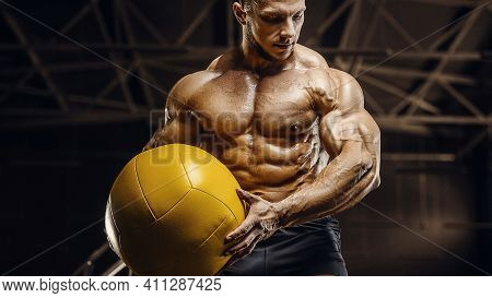 Handsome Athletic Men Pumping Up Muscles Workout With Ball Fitness Exercises And Bodybuilding Concep