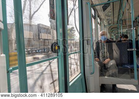 Karakoy, Istanbul, Turkey - 02.26.2021: Old Turkish Man With Corona Mask Sits In Tram While Moving I