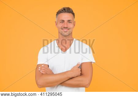 Confident And Optimistic. Confident Man With Crossed Arms Yellow Background. Happy Guy Smile With Co