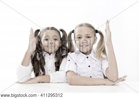 Back To School. Cute School Children Holding Up The Hands Isolated On White. Little Schoolgirls Havi