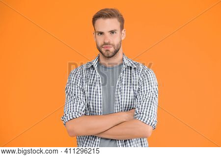 What Means Confidence For Men. Good Looking Stylish Guy Stand With Crossed Arms. Charismatic Fashion