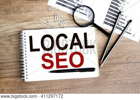 Local Seo. Text On White Paper On Wood Background