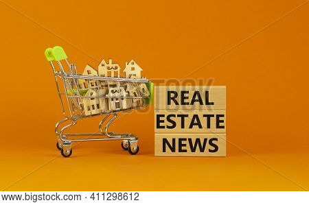 Real Estate News Symbol. Wooden Blocks, Words 'real Estate News' On Beautiful Orange Background. Sho