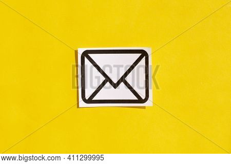 Photo Of An Email Sign On A Yellow Background