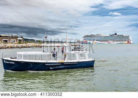Cabo San Lucas, Mexico - October 13 2019: Tender Boats Transport Passengers Between Docked Norwegian