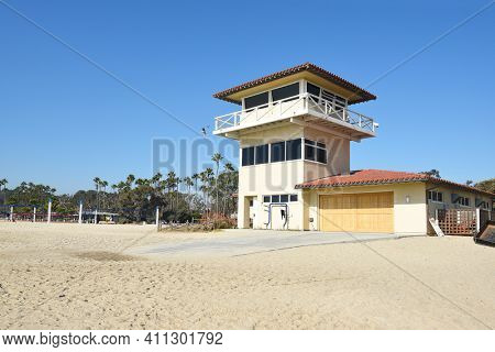 DANA POINT, CA - DECEMBER 1, 2017: Doheny State Lifeguard Tower and Beach Volleyball courts, lifeguard tower. The beach is a popular surf spot with Volleyball courts, picnic areas and campground.