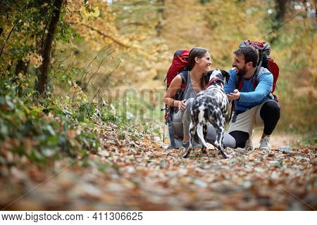 Young couple on hiking and enjoying with dog