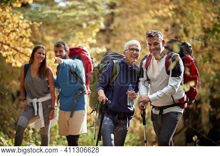 Group of hikers looking and enjoying in nature in autumn